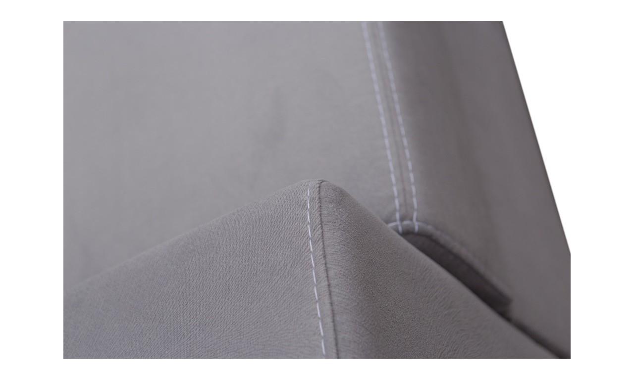 Biały narożnik z pufą, funkcją spania i pojemnikiem na pościel Mecenas